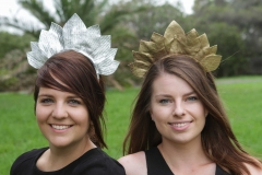 Tara-wears-a-silver-leather-leaf-design-headband-and-Hayley-wears-the-same-design-in-gold.